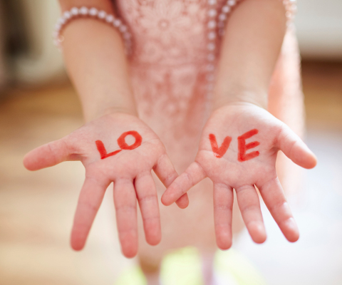 "Girl showing hands with inscription ""love"""
